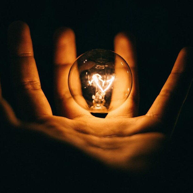 hand-bulb-lightbulb-filament